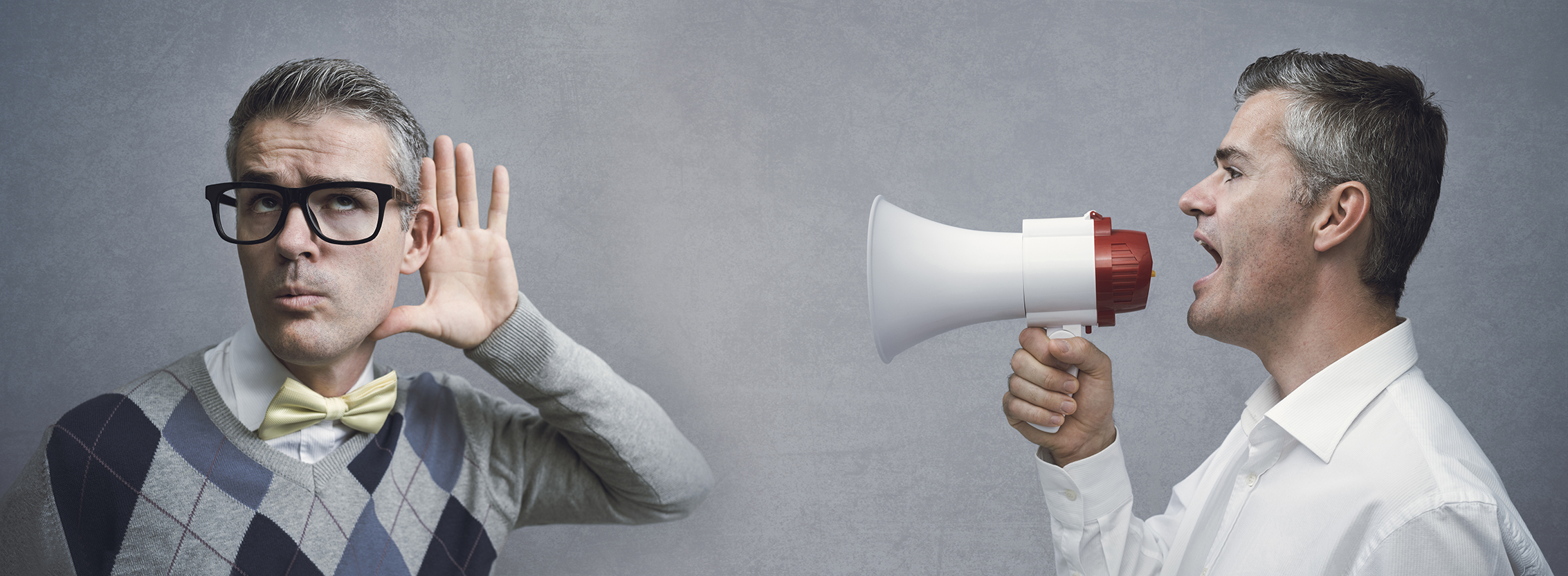 Confident man shouting with a megaphone and spreading his message, advertising and communication concept