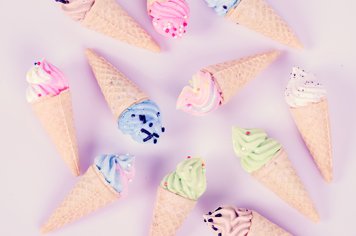 mini ice cream meringues in pastel colors, pattern abstract on pink background